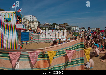 Punch and Judy show. Viking Bay beach. Broadstairs. Isle of Thanet. Kent. England. UK. - Stock Photo