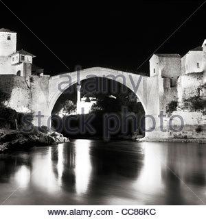 Stari Most (Old Bridge) over Neretva river at night, Mostar, Bosnia and Herzegovina - Stock Photo