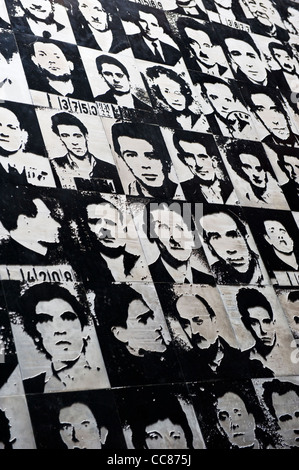 Wall exhibit of former prisoners in a courtyard at the House of Terror, 60 Andrassy St, Budapest, Hungary - Stock Photo