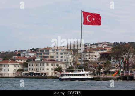 Turkish flag flying over the Bosphorus, Istanbul. - Stock Photo