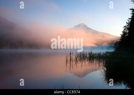 Foggy Sunrise over Trillium Lake with Mt Hood behind - Stock Photo
