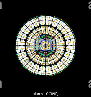 A colourful round stained glass window. - Stock Photo