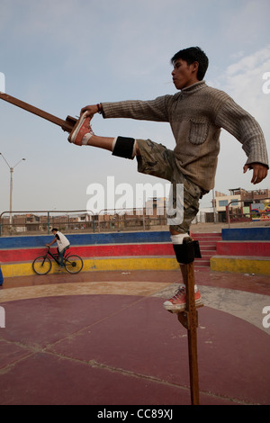 Youth practice walking on stilts in Lima, Peru, South America - Stock Photo