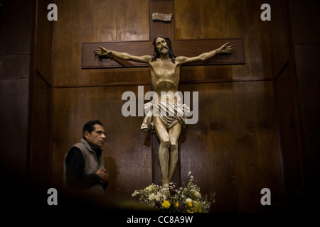 A parishioner attends mass at a cathedral in Lima, Peru, South America. - Stock Photo