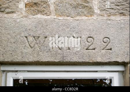 An inscription W K 1722 on a window lintel of the farmhouse door, Low New Houses, Baldersdale, Teesdale, County - Stock Photo
