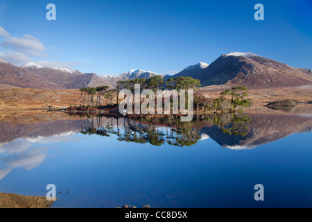 Winter reflection of the Twelve Bens in Derryclare Lough, Connemara, County Galway, Ireland. - Stock Photo