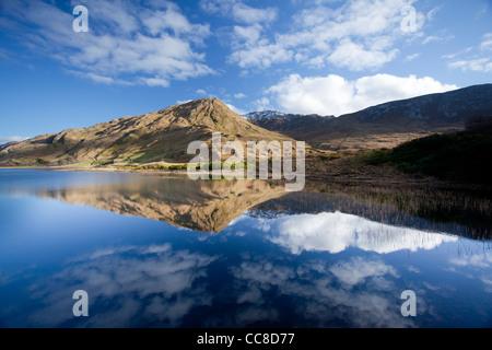 Reflection of Benbaun Mountain in Kylemore Lough, Connemara, County Galway, Ireland. - Stock Photo