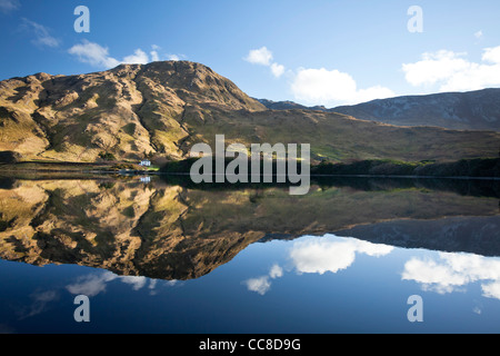 Evening reflection of the Twelve Bens Mountains in Kylemore Lough, Connemara, County Galway, Ireland. - Stock Photo