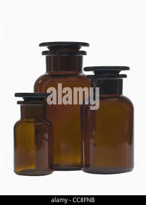Detail photo of three closed pharmacists bottles - Stock Photo