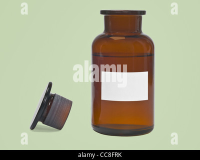 Detail photo of one opened pharmacists bottle - Stock Photo