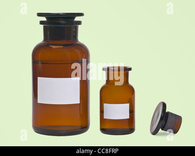 Detail photo of two pharmacists bottles, one is opened and one is closed - Stock Photo