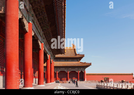 Part of the Hall of Complete Harmony, with the Hall of Supreme Harmony in the background, in the Forbidden City, Beijing, China.