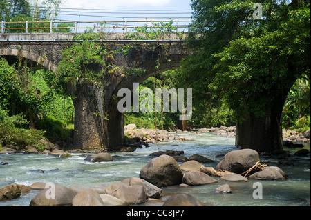 Bridge across the mountain river on Bali island, Indonesia - Stock Photo