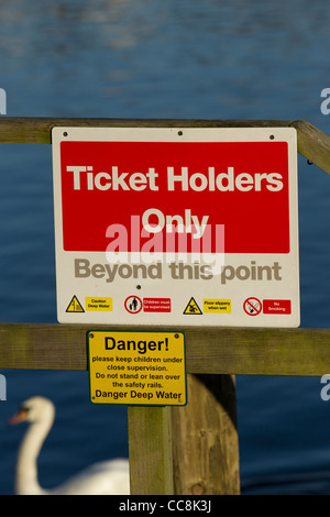 Danger Sign on Bowness Pier  Ticket Holders Only Beyond this point Sign - Stock Photo