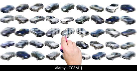 Man is choosing car from many different variants - Stock Photo