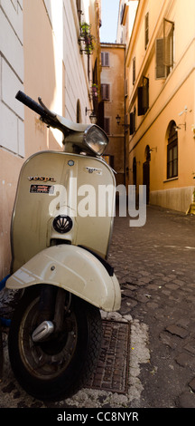 Scooter Vespa Piaggio parked in back street Rome Italy - Stock Photo