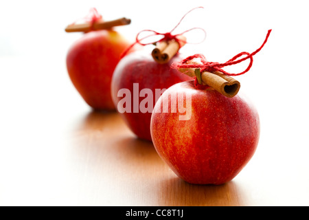 Close-up of delicious red Christmas apples with cinnamon sticks - Stock Photo