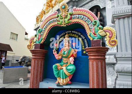 Female sitting Goddess in front of Sri Senpaga Vinayagar, Singapore. - Stock Photo