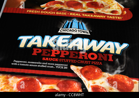 chicago town takeaway pepperoni sauce stuffed crust pizza - Stock Photo