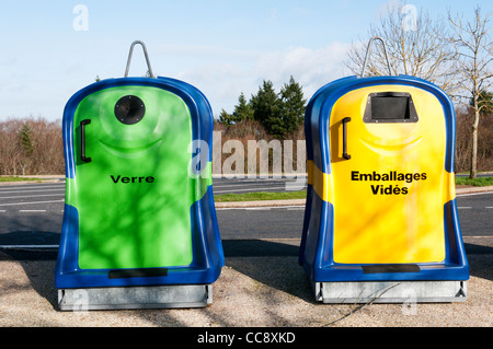 Two French recycling bins, for glass bottles and empty packaging. - Stock Photo