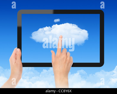 Woman hand holding black frame and touch the cloud against blue sky with clouds. Concept image on cloud computing - Stock Photo