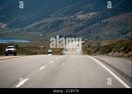 Driving along Highway 395 by Mono Lake, California. USA - Stock Photo