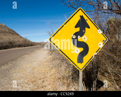 Bullet ridden road side signal on a country road near Marathon, west Texas, situated in the north tip of the Chihuahuan - Stock Photo