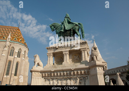 Hungary, Budapest, Castle Hill, Fisherman's Bastion. Statue of King Stephen in front of St. Matthias church. - Stock Photo
