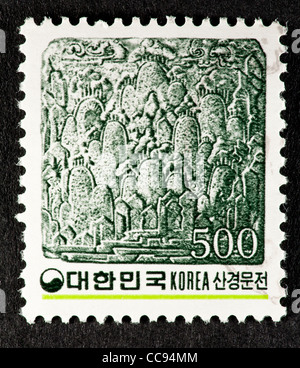Postage stamp from South Korea depicting mountain landscape in brick bas relief. - Stock Photo
