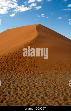 Tourists climbing Dune 45, Namibia - Stock Photo