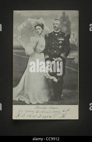 Dutch young queen Wilhelmina of Orangeantique and her German husband Hendrik von Meckelenburg in 1904 in a studio - Stock Photo