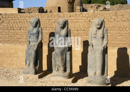 Statues of Goddess Sekhmet depicted with head of lioness and solar disk. Precinct of Mut. Karnak Temple Complex. - Stock Photo