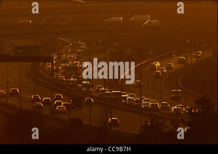 Motorway evening traffic on the M11 at junction with the M25 north of London, Essex, England. 13-1-2012 - Stock Photo