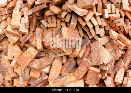 heap of red brick at day  - Stock Photo