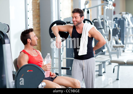 two men on a sport gym relaxed after fitness sport - Stock Photo
