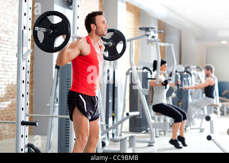 group with dumbbell weight training equipment on sport gym - Stock Photo