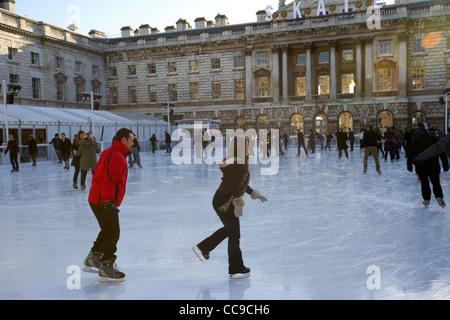 ice skating rink during christmas period at somerset house London England UK United kingdom - Stock Photo
