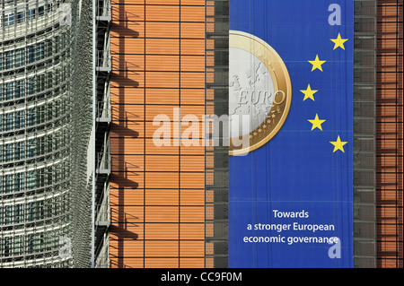 Banner about the euro hanging from building of the European Commission, executive body of European Union in Brussels, - Stock Photo