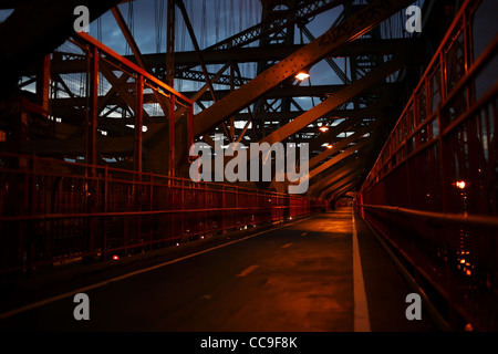 Cyclist's and pedestrians seen on the Williamsburg bridge in New York city, USA. - Stock Photo