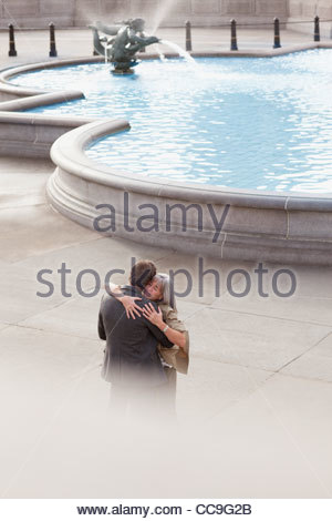 Couple hugging near fountain - Stock Photo