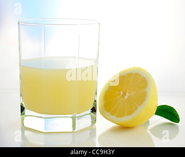 half of fresh lemon and lemon juice - Stock Photo