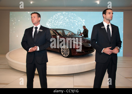 Models dressed as security agents protect the 2013 Lincoln MKZ at the Detroit Auto Show - Stock Photo