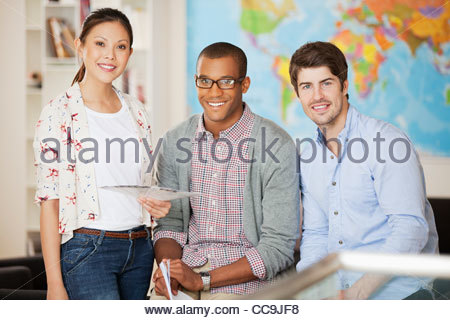 Portrait of smiling business people in office - Stock Photo