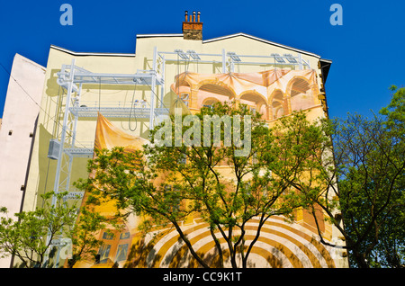 Mural and tree, Lyon, France (UNESCO World Heritage Site) - Stock Photo