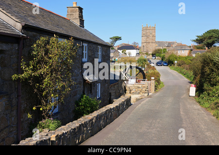 View along street to the country village church past the Wayside Folk Museum and Trewey Mill in Zennor Cornwall - Stock Photo