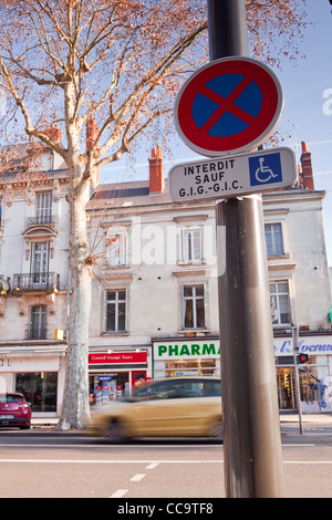 A no parking sign in Tours, France. It says that it is forbidden to park unless you are badge holder. - Stock Photo