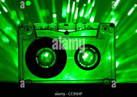 Transparent Cassette tape and green color disco lights background - Stock Photo