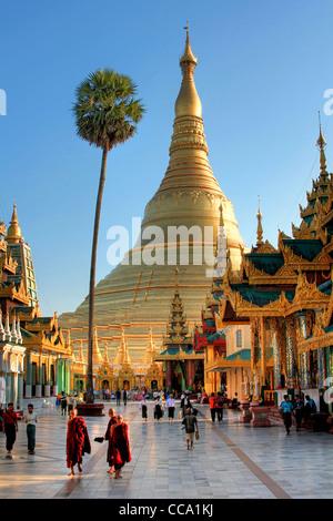 View of the Northern Entrance of the Shwedagon Paya (Pagoda) at Sunset   Yangon (Rangoon)   Myanmar (Burma) - Stock Photo