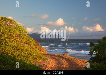 Fishing at Nukoli'i Beach, also known as Kitchens Beach, Kauai, Hawaii. - Stock Photo