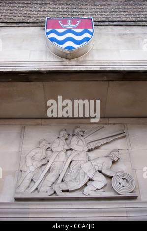Art Deco frieze, sculpture of firemen, former headquarters of London Fire Brigade, Albert Embankment, Lambeth, London, - Stock Photo
